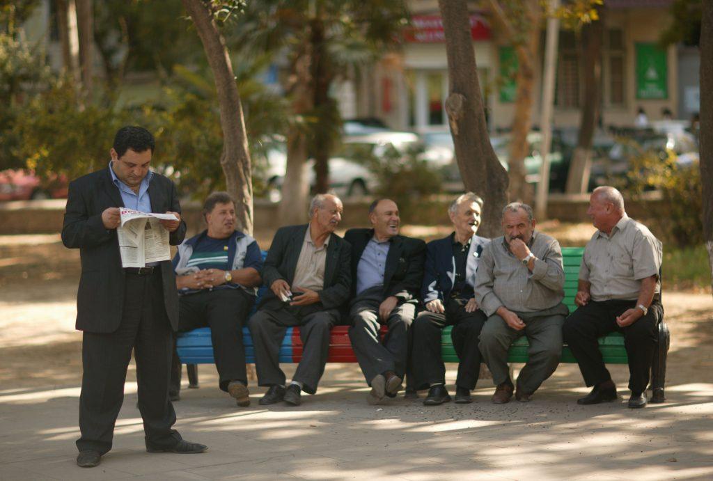 Azerbaijan Azeri men sitting on park bench